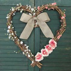 Just adorable! The perfect description for this heart wreath!    The base consists of a grapevine wreath in the shape of a heart. A mix of