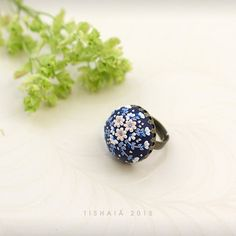 The night blushes. Handmade applique flowery polymer clay handmade polymer clay ring made out of navy blue fimo clay and adorned with tiny flowers. Applique, clay embroidery, etsy, SALE. #sale #polymerclay #clayjewelry