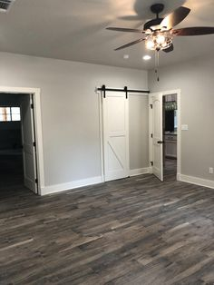 Wohnen Agreeable Gray with Alabaster trim, barn door and wood porcelain tile. Grey Hardwood Floors, Wood Tile Floors, Grey Flooring, Bedroom Flooring, Wood Look Tile Floor, Grey Wood Tile, Laminate Flooring, Living Room Wood Floor, Living Room Grey