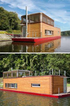 maison sur l'eau de design original avec bardage extérieur en bois massif et intérieur de luxe