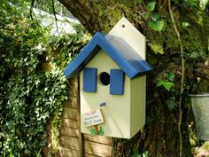 blue bird house with shutters