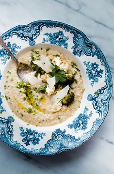 Quinoa Risotto with White Beans. This easy and healthy main course recipe is made creamy with white bean puree and topped with crispy brassica florets!