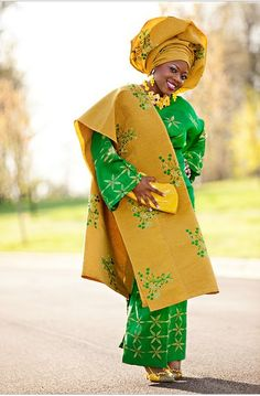 West #African lady in her traditional wear. The colour combination is fantastic!