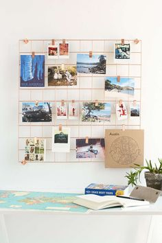 this wire grid is pretty cute for wild wall--wonder if we could get a standard kitchen wire rack and spray paint it...