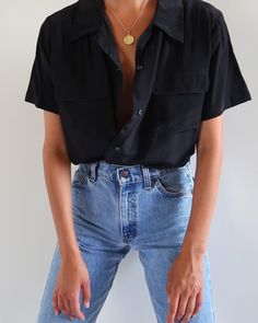 SOLD Vintage black 100% silk short sleeve blouse with front pockets, best fits xs-m. $46 + shipping.