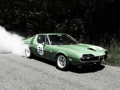 not something you see everyday - burnout in a green Alfa Romeo Montreal