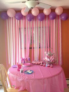 photo booth idea - tie balloons to curtain rod to hide the top of the streamers.