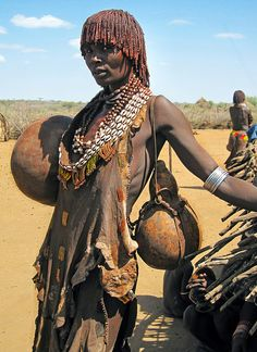 Africa |  People.  Hamar woman with wide calabash bowl and drinking gourd.  Photo taken by David Schweitzer.