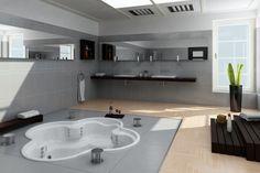 Esto es nuestro magnífico baño.  En el suelo hay una magnifica bañera de hidromasaje blanca. Las paredes son de color gris recubierta de espejos y el suelo es de parquet. A mano derecha hay una gran ventana y delante de ella como decoración hemos puesto una planta muy bonita. Por último el usual parquet.