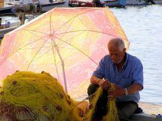 Mending fishing nets in Greece