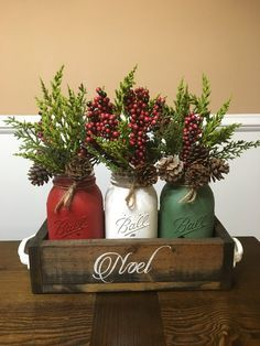 This is a perfect way to ring in the holiday season with this rustic Christmas centerpiece. Dimensions: Quart sized jars Package includes: planter box (dark walnut) with hand painted stencil christmas chalk painted mason jars flow Christmas Jars, Christmas Colors, Christmas Home, Christmas Holidays, Christmas Kitchen, Christmas Lights, Christmas 2019, Christmas Cactus, New Year Holidays