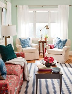 The coral sofa was the starting point for the colour scheme, and Michael picked up the blue by adding toss cushions, pottery, and a striped rug.