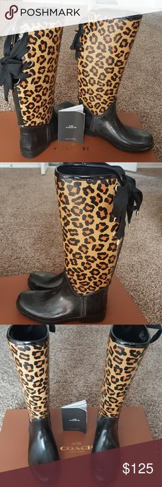 """Authentic Coach rainboots Worn once. Tristee Outline. A few minor scratches. Animal print with black rubber, and lace tie back. 1.5"""" heel, 16"""" shaft. Comes with tags and box Coach Shoes Winter & Rain Boots"""