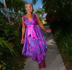 Tropical elegance meets vibrant hues and delicate fabric to create a flattering, free flowing dress for every Mother of the Bride.