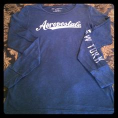 Aeropostale Navy Blue Long Sleeve Tee This tee is so comfy. It is long sleeve, lightweight, and goes perfect with jeans or it can be worn with yoga pants or leggings for a more casual look. It is 100% cotton and runs small. It fits more like a large. Aeropostale Tops Tees - Long Sleeve