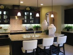 Kitchen: dark cabinets, light floor and backsplas, and light speckled granite counter tops :)