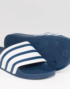 new style 29502 40d67 adidas Originals Adilette sliders in Blue White
