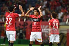 Toshiyuki Takagi #13 of Urawa Red Diamonds celebrates the third goal during the J.League Levain Cup match between Urawa Red Diamonds and Vissel Kobe at the Saitama Stadium on September 4, 2016 in Saitama, Japan.