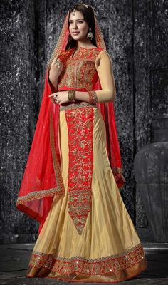 You will be ready to be in spotlight as you glide in this cream and red net embroidered lehenga cholie. The charming butta, lace, resham and stones work a vital element of this attire. Upon request we can make round front/back neck and short 6 inches sleeves regular cholie blouse also. #AdorableALineCutCholi