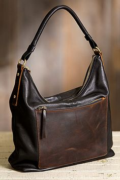 Two-tone Argentine cowhide leather with its gracefully curved zip top makes a chic everyday shoulder bag that holds it all. Free shipping + returns.