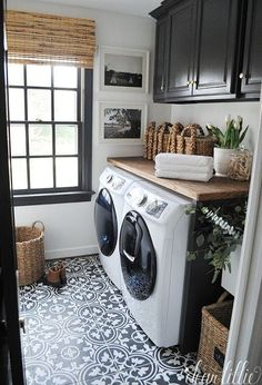 Black and White Medallion Tiles coordinate with the rest of a stylish laundry room