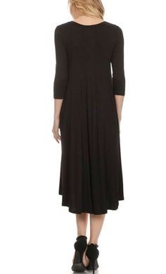 Metilda 3/4 sleeve solid colored A-line midi dress in Black.