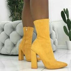 1df6e7d2df7 Absolutely loving these canary yellow bold boots! Pair with Haute   Heir s  Prophecies of Pythia pendant to add soft subtly to the look without  detracting ...