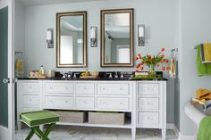 The double vanity offers maneuvering space and clutter-busting storage. | Vanity: http://www.gregaanesfurniture.com/ | Sinks: @kohlerco | Stool: @target | Photo: Robert Trevis-Smith/Moment/Getty Images