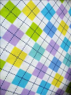 Argyle - A pattern of overlaping solid and outlined diamond shapes. - Fabric Glossary