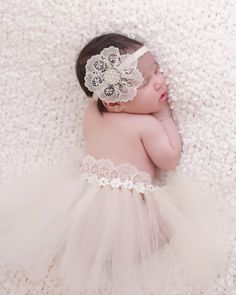 Welcome your little princess to the world in style with this ivory newborn tutu and lace headband set from ChicCrystalsBoutique. Custom