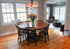 Dining area in kitchen with round table, hanging light fixture.