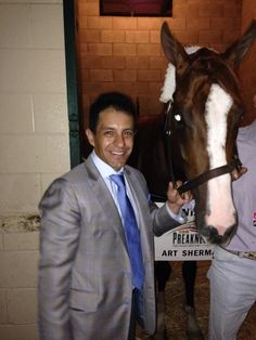 Jockey Victor Espinoza visits California Chrome after their win in the Hollywood Derby