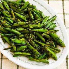 Recipe for Spicy Stir-Fried Sugar Snap Peas with Soy Sauce, Sesame Oil, and Sriracha [from KalynsKitchen.com]