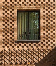 Haghighi Residential Building / Boozhgan Architecture Studio + AAD Studio