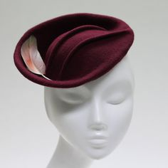 This listing is for my Kiru II Hat This item is MADE TO ORDER  A very chic and tidy burgundy wool felt hat with a right hand side upswept brim design, suitable for weddings and Race Meeting events. This hat is hand blocked, sculpted then accented with a small feather. The brim edge is professionally finished with millinery wire. A discreet black metal headband secures the hat in place. The hat can be moved along the headband and positioned to suit the face of the wearer. If you have any…