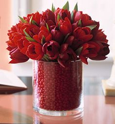 Christmas or Valentine Floral Centerpiece~ Change the flowers to roses or poinsettias if you want. (Note: a smaller vase is hidden inside) ...red hot candies in the larger cylinder, and flowers with water in another cylinder on the inside.