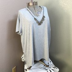 """Sejour gray embellished v neck t-shirt Nordstrom brand. Beading is detachable. Length 30"""" very stretchy. Sejour Tops Tees - Short Sleeve"""