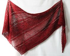 Paid pattern....Simple & chic one skein wonder with bias construction, garter stitch and eyelets.