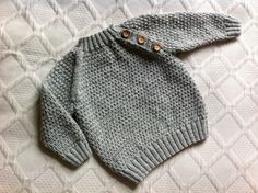 Baby sweater ~ This is a modified (beautifully so) Drops design sweater with a side button opening.