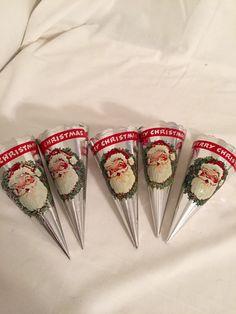 A personal favorite from my Etsy shop https://www.etsy.com/listing/215353273/vintage-foil-santa-cornucopia-christmas