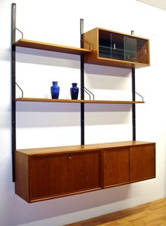 Modular teak wall unit designed by Poul Cadovius.