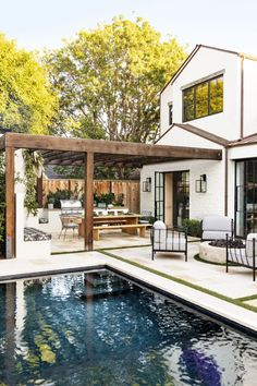outdoor living space with pool - outdoor living ; outdoor living on a budget ; outdoor living space on a budget ; outdoor living space with pool ; Indoor Outdoor Kitchen, Outdoor Kitchen Design, Outdoor Dining, Outdoor Spaces, Dining Area, Patio Dining, Backyard Kitchen, Outdoor Living Rooms, Summer Kitchen