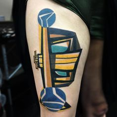 London-based tattoo artistMike Boydis a dedicated traveler, viewing the act as a necessary component to developing his style of cubist-focused tattoos. His bright and angular work features Picasso-like faces and segmented bodies, impactful tattoos that make it difficult to discern skin from canvas