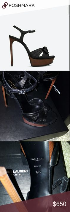 SAINT LAURENT SANDAL WITH STACKED LEATHER PLATFORM SAINT LAURENT SANDAL WITH STACKED LEATHER PLATFORM AND HEEL, 2 CRISSCROSSING FRONT STRAPS WITH CENTRAL BOW AND EXTENDED FOOTBED.  TOTAL HEEL HEIGHT 5.3 INCHES  PLATFORM HEIGHT 1.2 INCHES  ARCH HEIGHT 4.1 INCHES Yves Saint Laurent Shoes Sandals