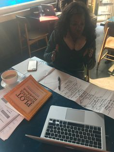"""""""Know what's fun? Seeing a writer hard at work in a cafe using an admired colleague's book."""" (from Twitter)"""