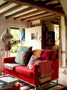 So rustic and interesting. I love the red couch, of course!