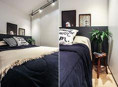 O dormitório recebeu trilhos de iluminação e tem um banquinho simples (e cheio de bossa) como criado-mudo, apoiando um vaso e alguns livros (Foto: Divulgação)
