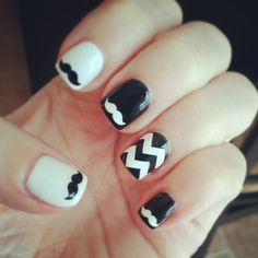 Another awesome mustache nail art idea! but I think the mustaches should be the same color on each nail. Maybe do a black and silver instead of white with a red mustache :3