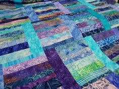 Batik quilt by Sue Astroth from the Sunday Morning Quilt design by Cheryl Arkinson