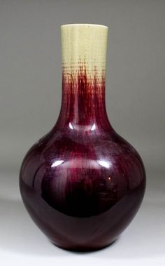 A Chinese flambe glazed stoneware bottle vase, 16ins (407mm) high (19th Century)